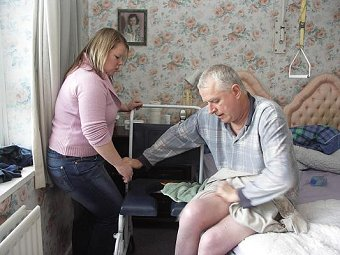 disabled man and carer at home
