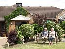 Elderly people in front garden of care home