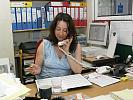 Woman at work answering the phone