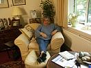 Old woman relaxing at home with feet up