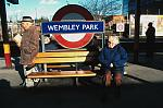 elderly man and woman on bench at Wembley Park station