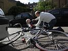man attends elderly cyclist after collision with car