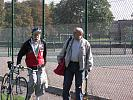 Old man, with bike, and friend in park