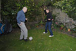 Foster parent and child playing football