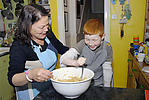 Looked-after child and foster mother sharing the cooking