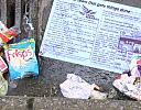 Political party leaflet among discarded rubbish