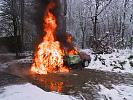 Abandoned car in flames