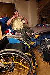 Disabled man happily getting dressed