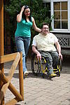 Striding out: Disabled man and partner going for a walk