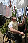Wash-day blues: Disabled man with laundry
