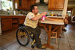 Disabled man cleaning the kitchen