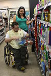 Disabled man in the supermarket with his partner
