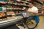 Disabled man shopping in the supermarket
