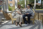 Elderly lady in care home conservatory with grand-daughter