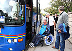 Disabled fan getting off coach