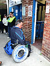 Football fan with disability entering stadium