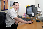 Man with Down's Syndrome using computer at work