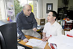 Man with learning disability conferring with work colleague