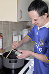 Man with Down's Syndrome cooking at home