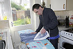 Independent living: Man with Down's Syndrome ironing