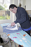 Man with learning disability ironing