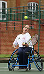Disabled tennis player keeps his eye on the ball