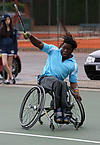Disabled tennis player plays a shot
