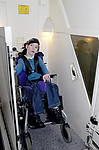 Physically disabled teenager in adapted lift