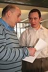 Man with Down's Syndrome in discussion with colleague