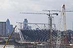 London Olympic Stadium under construction with backdrop of City