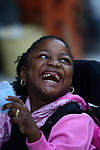 Child with physical and learning disabilities enjoys the moment