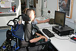 Disabled teenage student participating in IT lesson