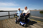 Elderly couple in wheelchairs enjoying the view