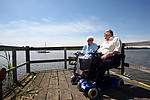 Elderly, disabled couple on holiday