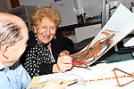 Elderly woman enjoying the moment in art group
