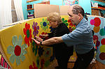 Elderly people producing scenery for day centre play