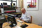 Social worker at his desk