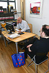 Social worker on telephone while service user waits