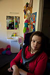 Disabled woman in her room in an independent living setting