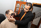 Optician doing assessment at patient's home