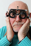 Elderly man having eyes tested