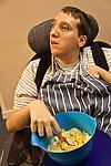 Disabled man preparing a meal