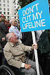 Elderly disabled person demonstrating against government cuts