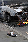 London riots, juxtaposition of stolen shoe and burned car