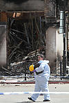 London riots, forensic officer surveys scene