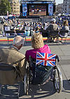 Disabled spectators watching Paralympics 2012 on big screen at Trafalgar Square