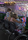 Disabled woman and children watching Paralympics 2012