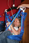 Disabled woman controlling hoist