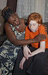 Anxious looked-after adolescent being consoled by foster mother