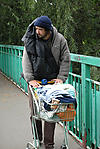 Homeless man with supermarket trolley